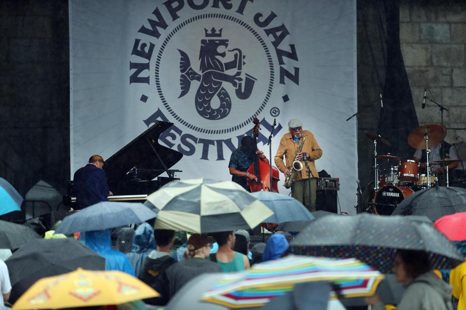 Saxophonist Charles Lloyd and his band performed on a rainy Saturday at the Newport Jazz Festival.