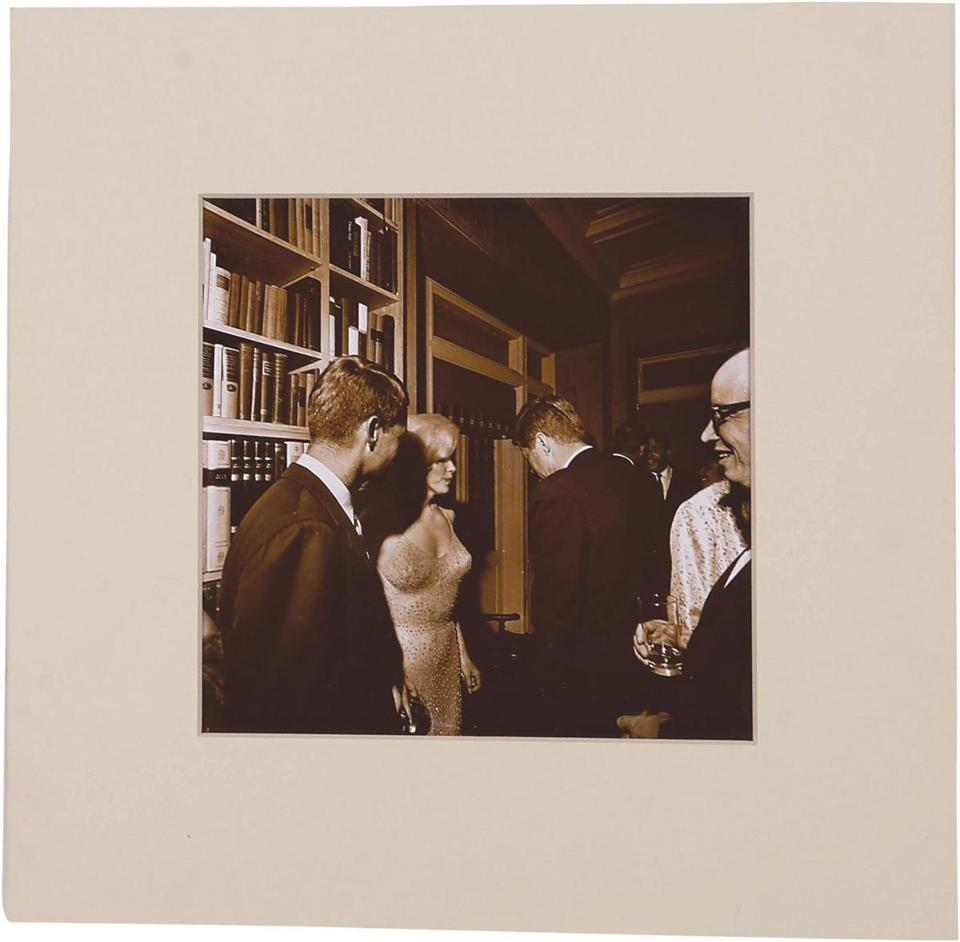 Attorney General Robert F. Kennedy (L), Marilyn Monroe, and President John F. Kennedy (R). (Cecil W. Stoughton, Courtesy of Lelands Auctions)