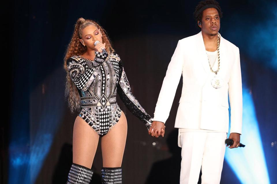 Beyoncé and Jay-Z onstage at Gillette Stadium on Sunday.
