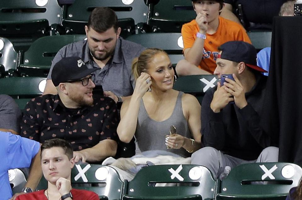 Singer and actress Jennifer Lopez (center) sat in the stands during a game between the Red Sox and Astros earlier this season. Lopez was at Fenway Park on Sunday.
