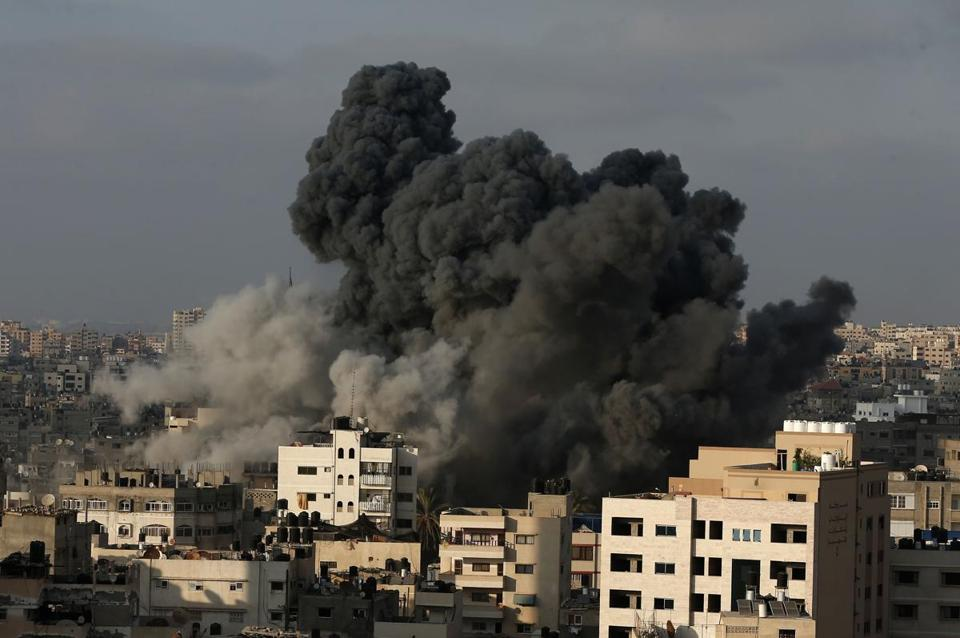Smoke billowed from buildings in Gaza City on Thursday following an Israeli air strike, one of hundreds by Israel.
