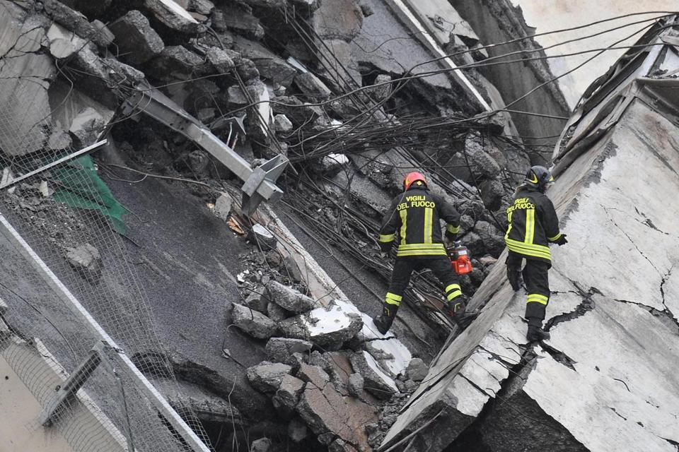 Rescuers worked among the rubble