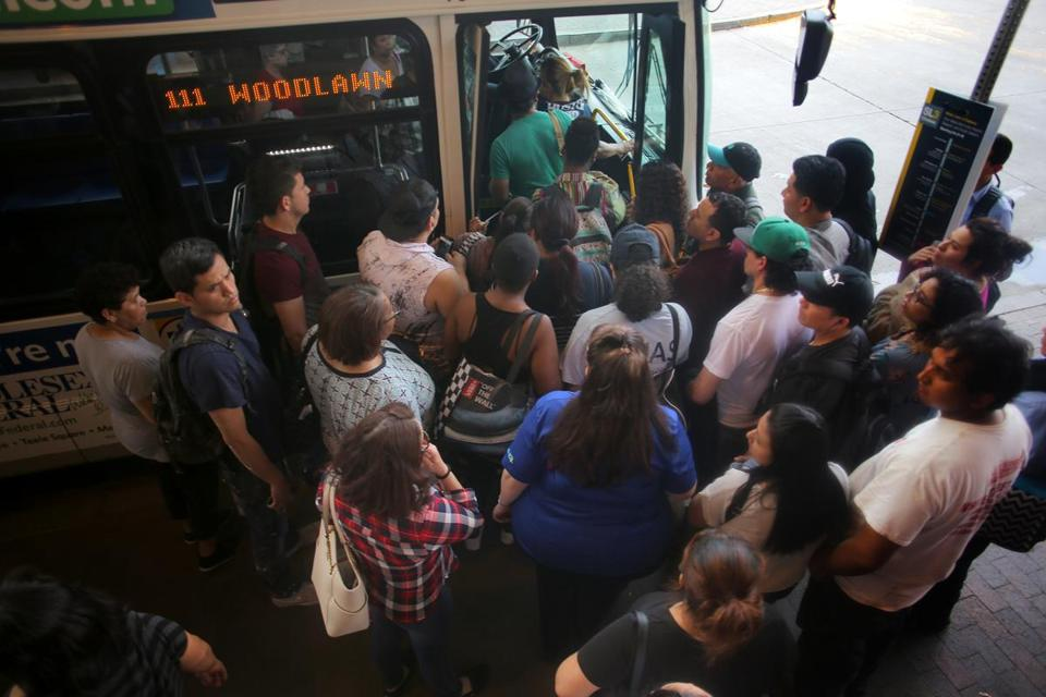 Boston, MA - 05/15/18 - Passengers wait for the 111 bus to Chelsea and Revere at the Haymarket Square stop in Boston. The 111 bus, one of the busiest, most crowded, and most regularly canceled, on the entire MBTA network. (Lane Turner/Globe Staff) Reporter: (Adam Vaccaro) Topic: (07chelseabus)