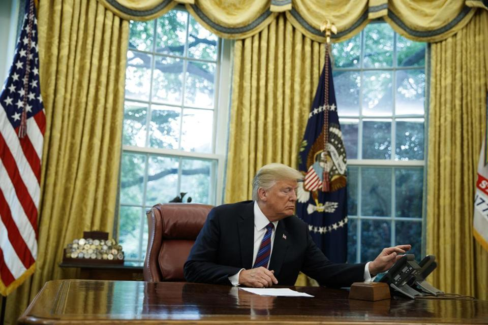 President Donald Trump talks on the phone with Mexican President Enrique Pena Nieto in the Oval Office of the White House Monday Aug. 27 2018 in Washington. Trump is announcing a trade