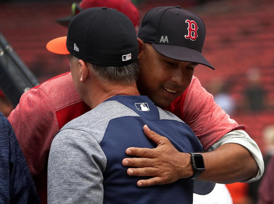 Boston, MA - 9/07/2018 - Boston Red Sox manager Alex Cora embraces Houston Astros manager AJ Hinch during the team's pre game warmups. The Boston Red Sox host the Houston Astros in Game 1 of a three game series at Fenway Park. - (Barry Chin/Globe Staff), Section: Sports, Reporter: Peter Abraham, Topic: 08Red Sox-Astros, LOID:8.4.3074412130.