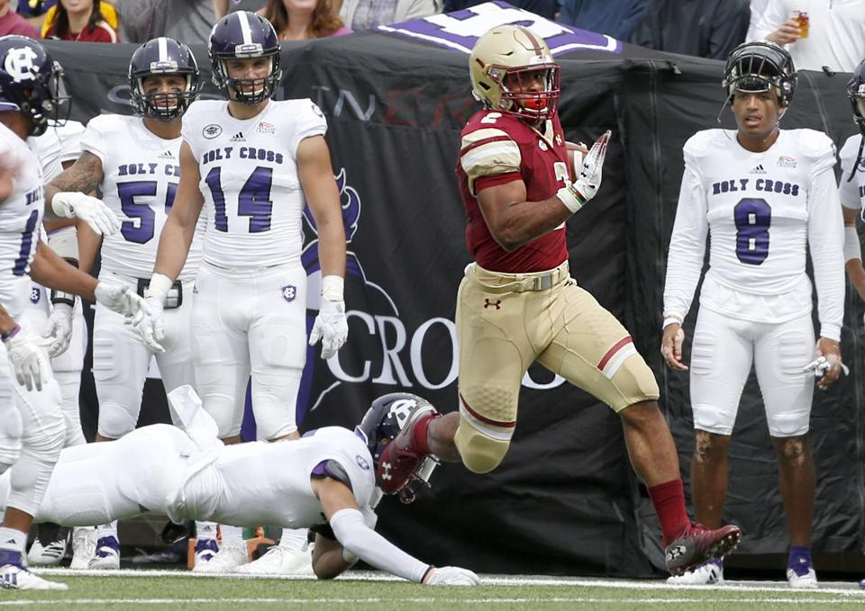 Boston College running back AJ Dillon left Holy Cross in the dust early and often, rushing for three touchdowns in the first eight minutes.