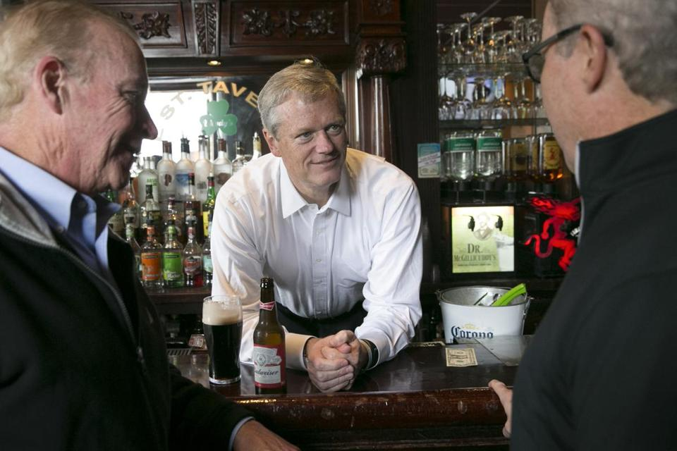 September 9, 2018 - L Street Tavern Governor Charlie Baker tends bar and talks with Brian McCourt (R) (R) and patron Paul McCourt of Newton, MA (L) Governor Charlie Baker campaigns at the L Street Tavern in South Boston Photo by Katherine Taylor for The Boston Globe