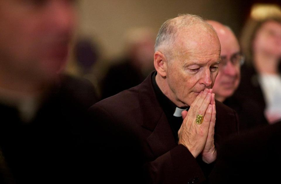 (FILES) In this file photo taken on November 11, 2002, Archbishop of Washington Cardinal Theodore McCarrick prays during a prayer for deceased bishops at the start of the morning session of the US Conference of Catholic Bishops being held in Washington, DC.