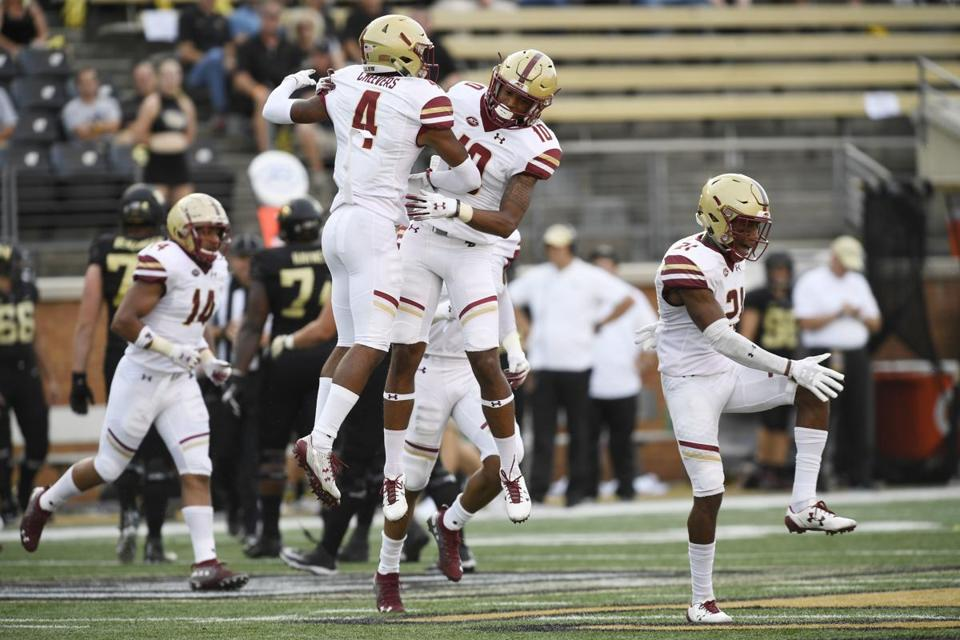 Hamp Cheevers (4) and Brandon Sebastian (10) celebrate Cheevers' interception during the first half of BC's 41-34 victory at Wake Forest.