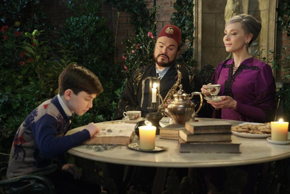 "Owen Vaccaro, Jack Black, and Cate Blanchett in ""The House With a Clock in Its Walls."""