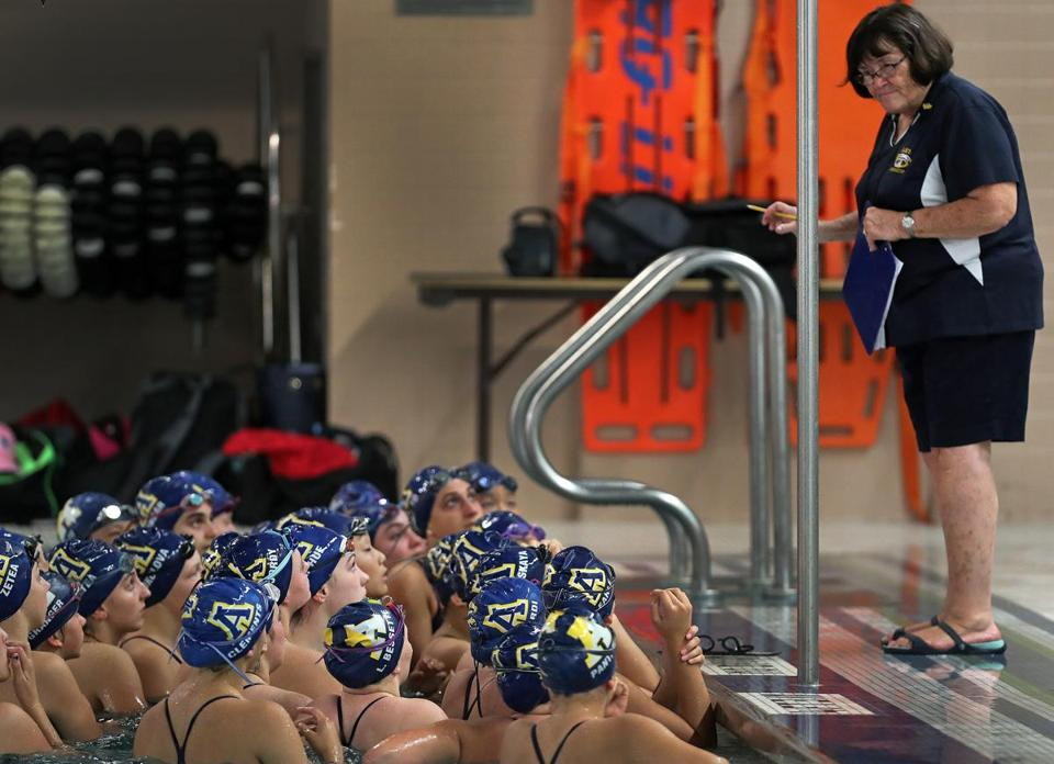 Andover, MA: 9-18-18: Andover High School swimmers listen as coach Marilyn Fitzgerald (right) gives them some last minute instructions at the Greater Lawrence Technical School before a meet. (Jim Davis/Globe Staff)