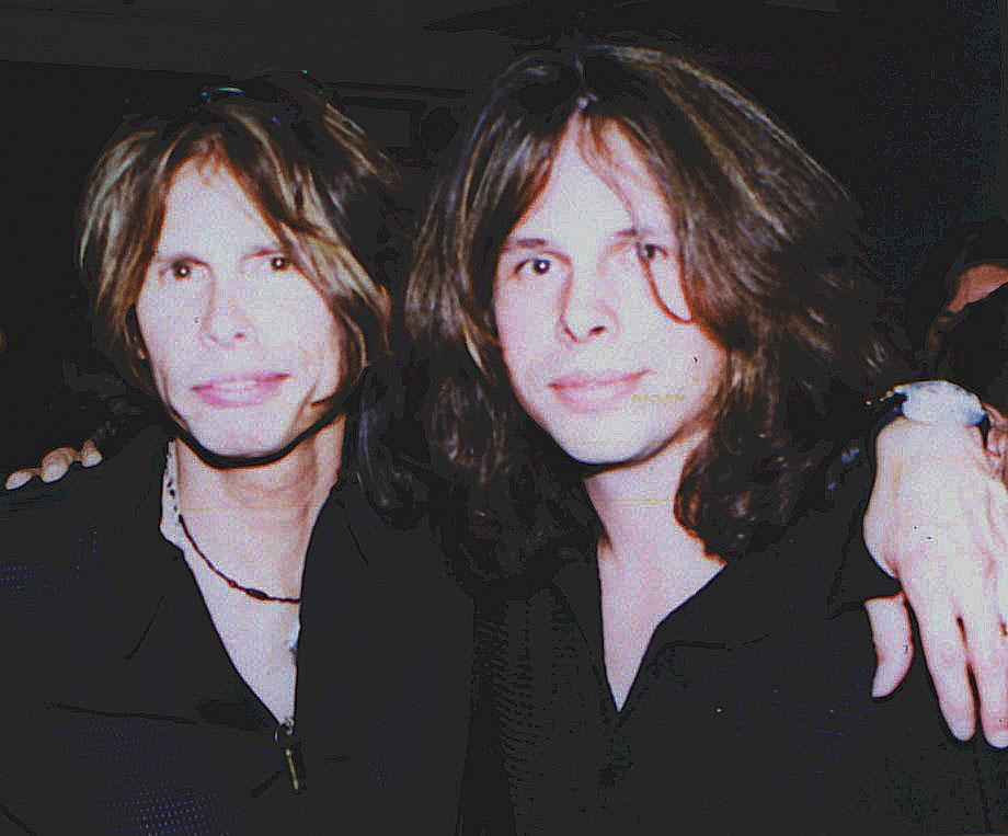 Neill Byrnes with Steven Tyler in 2004;