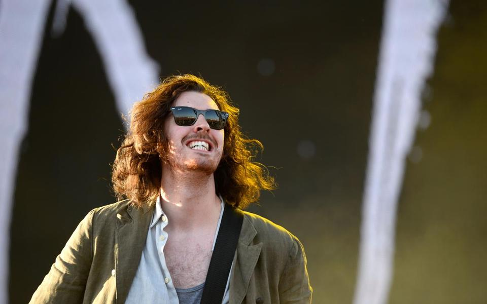 "(FILES) In this file photo taken on April 11, 2015 Hozier performs on the second day of the Coachella Music Festival in Indio, California. - Hozier on Thursday September 6, 2018, released his first new music in four years, a stirring tribute to the activism of Nina Simone and other singing greats. The Irish singer and guitarist found a global audience after his 2013 Grammy-nominated breakthrough ""Take Me To Church,"" a hard-charging but folk-rooted song that indicts organized religion over homophobia. (Photo by Robyn BECK / AFP)ROBYN BECK/AFP/Getty Images 30Hozier"