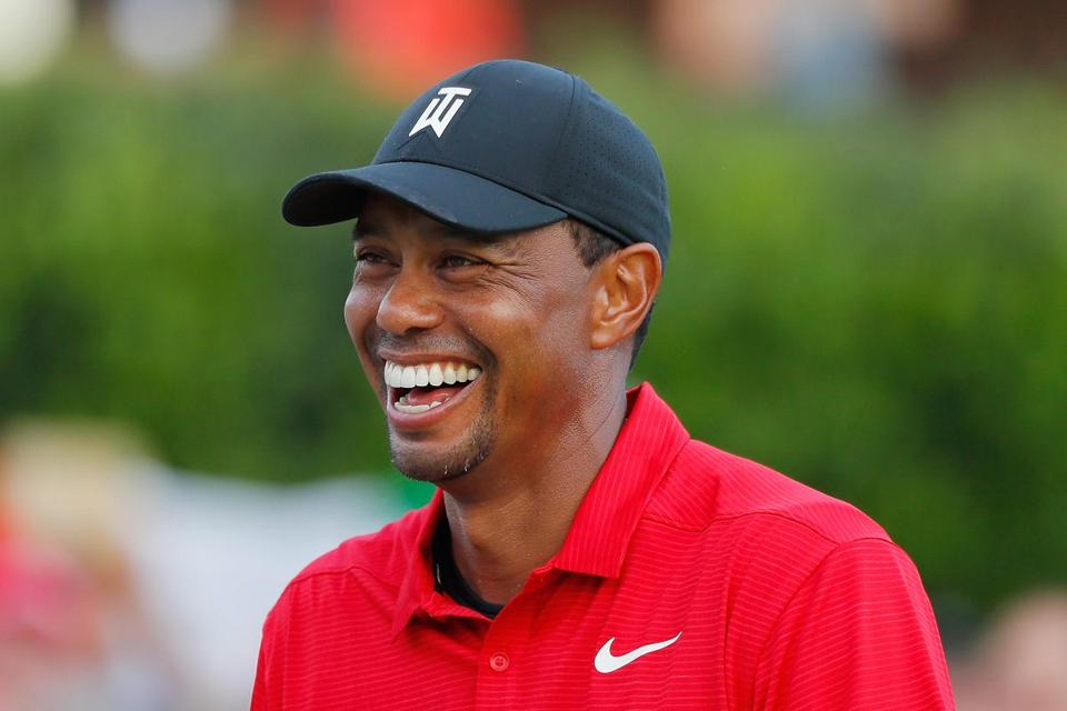 ATLANTA, GA - SEPTEMBER 23: Tiger Woods of the United States reacts during the trophy presentation ceremony after winning the TOUR Championship at East Lake Golf Club on September 23, 2018 in Atlanta, Georgia. (Photo by Kevin C. Cox/Getty Images)