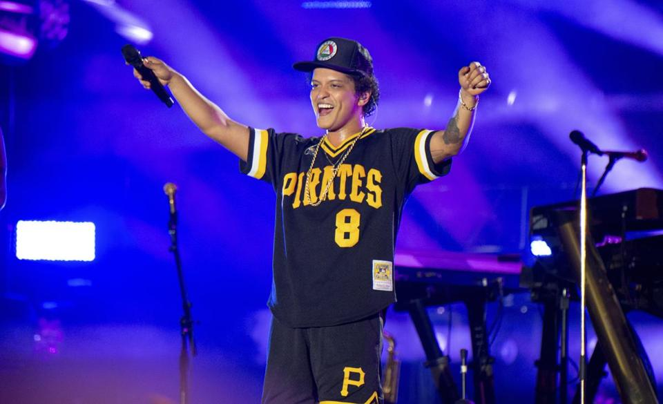"FILE - In this May 27, 2018 file photo, Bruno Mars performs at the Bottle Rock Napa Valley Music Festival at Napa Valley Expo in Napa, Calif. Cardi B may have backed out of the Bruno Mars tour, but he's found four other acts to hit the road with him. Mars announced Tuesday, Aug. 14, 2018, that Boyz II Men, Charlie Wilson, Ciara and ""Boo'd Up"" singer Ella Mai will perform during his upcoming fall concerts on his 24K Magic World Tour. (Photo by Amy Harris/Invision/AP, File) 09FallPopPicks"