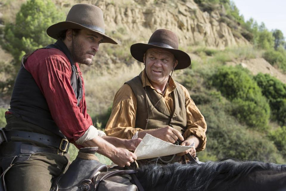 "Joaquin Phoenix (left) and John C. Reilly star in ""The Sisters Brothers."""