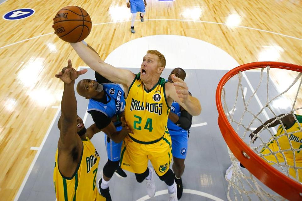 Scalabrine grabs a rebound against Cuttino Mobley during Big3 three-on-three basketball league play in Duluth, Georgia.