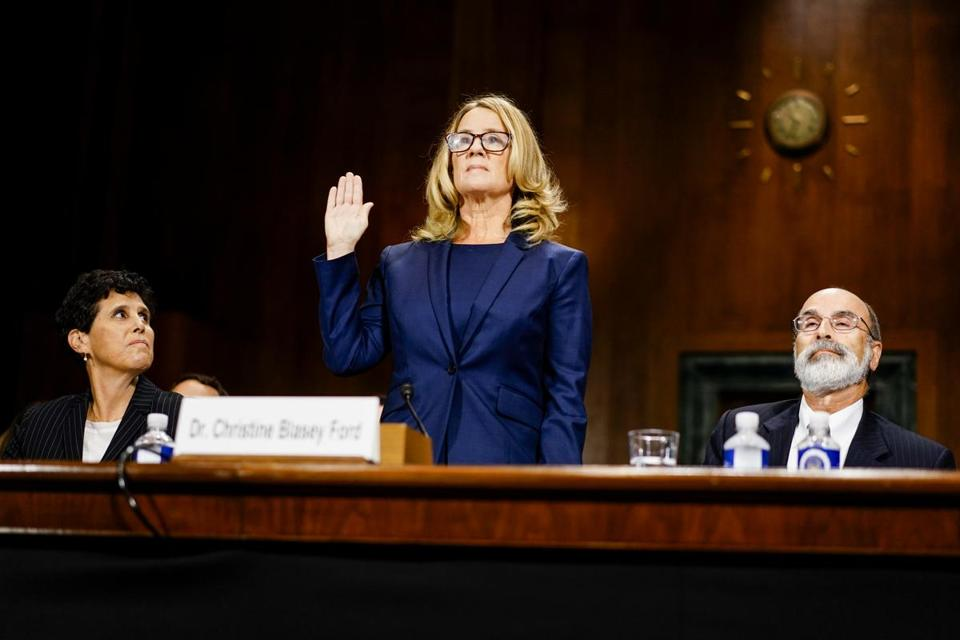 WASHINGTON, DC - SEPTEMBER 27: Christine Blasey Ford swears in at a Senate Judiciary Committee hearing in the Dirksen Senate Office Building on Capitol Hill September 27, 2018 in Washington, DC. A professor at Palo Alto University and a research psychologist at the Stanford University School of Medicine, Ford has accused Supreme Court nominee Judge Brett Kavanaugh of sexually assaulting her during a party in 1982 when they were high school students in suburban Maryland. (Photo by Melina Mara-Pool/Getty Images)