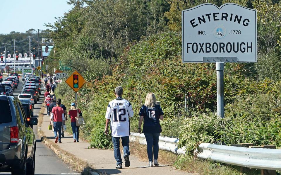 Two Tom Brady sweater wearers make the trek to the Gillette stadium.