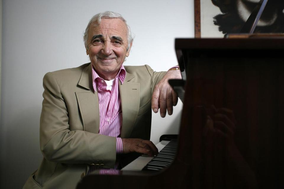 Mr. Aznavour sang songs he wrote in French, Armenian, English, German, Italian, Spanish, and Yiddish.