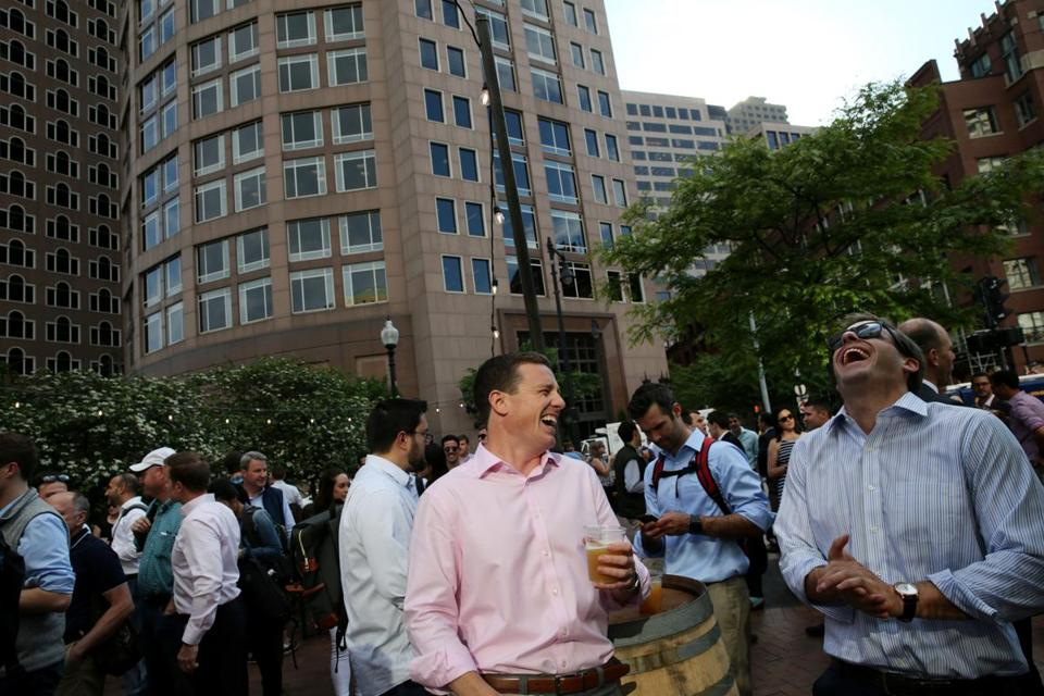 Boston, MA- June 01, 2017: Colton Dwyer, left, and Matt Quinlan share a laugh while visiting Trillium Garden on the Greenway in Boston, MA on June 01, 2017. 2014. The cult favorite among beer drinkers — opened its outdoor beer garden on Boston's Rose Kennedy Greenway Thursday. The seasonal open-air beer garden, which will run weekly through October, is free to get into, with draft beer from Trillium and wine from Westport Rivers Winery available for purchase. (Globe staff photo / Craig F. Walker) section: metro reporter: