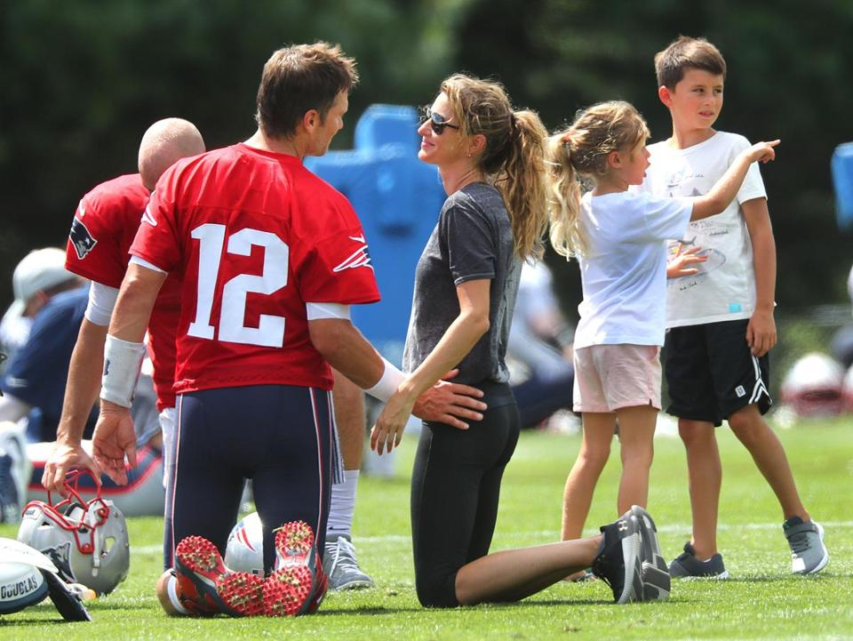 Gisele Bundchen chatted with her husband Tom Brady earlier this year during Patriots' training camp, as their children lingered in the background. Bundchen and Brady had two small marriage ceremonies, the supermodel reveals in her new book.