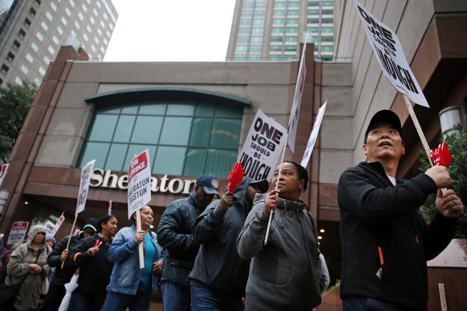 Workers and supporters picketed outside the Sheraton Boston by Marriott.