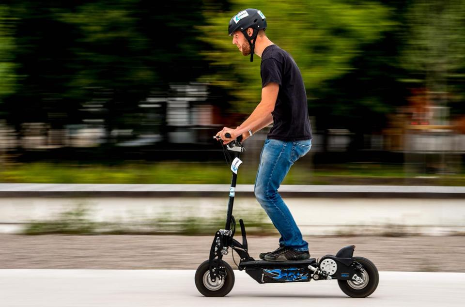 (FILES) In this file photo taken on June 23, 2018 a man rides an electric scooter in Lille, northern France. - New forms of transport compete with scooters, representing the most dynamic market in France with one million scooters in circulation, AFP reported on October 1, 2018. (Photo by Philippe HUGUEN / AFP)PHILIPPE HUGUEN/AFP/Getty Images