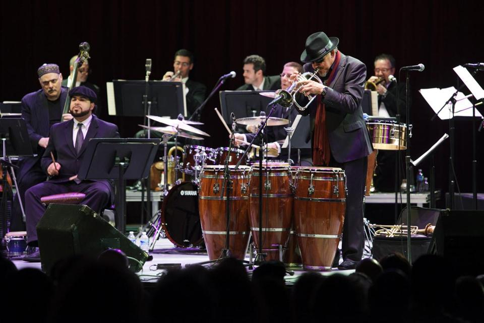 FILE -- Jerry González, right, on fluegelhorn, and his brother Andy, on bass, performing with Arturo O'Farrill and the Afro Latin Jazz Orchestra at Symphony Space in New York, Oct. 14, 2011. Jerry González, a trumpeter and percussionist who was a central figure in Latin jazz, especially through the Fort Apache Band, died on Monday in Madrid. He was 69. (Willie Davis/The New York Times)