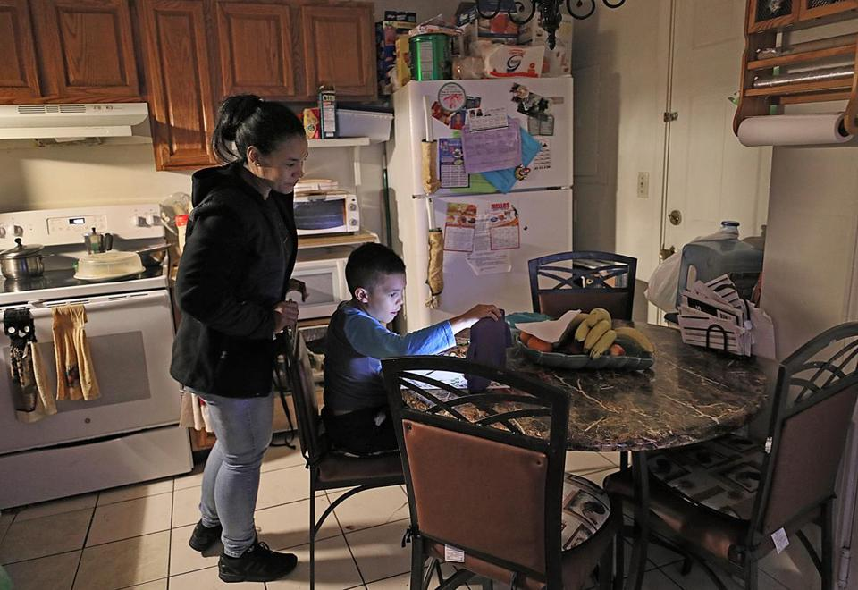 Elizabeth Bautista set her son up with a tablet before heading to a business class in the evening.