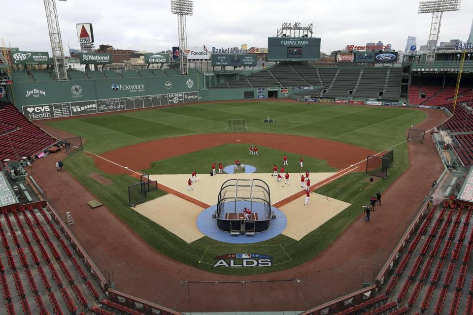 Boston Red Sox players practice during a baseball workout at Fenway Park Wednesday. The Red Sox will face the Yankees in the American League division series on Friday.