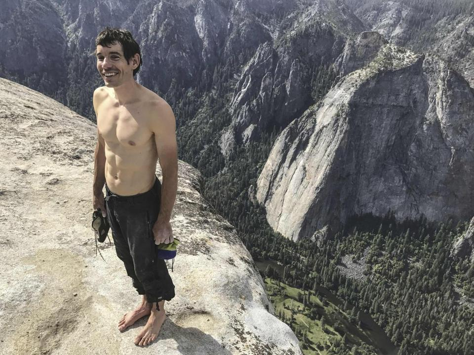 "This handout photo obtained October 3, 2018 courtesy of National Geographic/Jimmy Chin shows Alex Honnold as he holds all of his climbing gear atop the summit of El Capitan,in Yosemite National Park, becoming the first person to climb El Capitan without a rope. - A new documentary follows Alex Honnold as he attempts a free solo ascent of El Capitans Freerider in Yosemite National Park in California. Imagine climbing a 900-meter (3,000-foot) granite wall without ropes and almost nothing to grip, moving slowly and perilously upward for four hours. A brave soul named Alex Honnold completed such a climb -- and lived to tell the tale. Honnold was 31 when he pulled off the feat of scaling El Capitan, a vertical rock formation in Yosemite National Park in California, in June 2017 in a drama that is now the subject of a National Geographic documentary. The film is in US theaters now, in Canada starting October 12 and in the UK in December. (Photo by Jimmy CHIN / National Geographic/Jimmy Chin / AFP) / RESTRICTED TO EDITORIAL USE - MANDATORY CREDIT ""AFP PHOTO / NATIONAL GEOGRAPHIC/JIMMY CHIN"" - NO MARKETING NO ADVERTISING CAMPAIGNS - DISTRIBUTED AS A SERVICE TO CLIENTS / TO GO WITH AFP STORY BY IVAN COURONNE: New film documents terrifying Yosemite rock climb, daredevil who did itJIMMY CHIN/AFP/Getty Images"