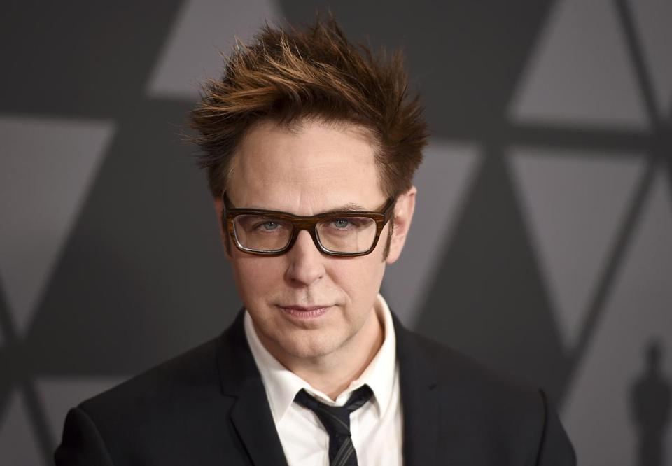 "FILE - In this Nov. 11, 2017 file photo, director James Gunn arrives at the 9th annual Governors Awards in Los Angeles. Warner Bros. on Tuesday confirmed that Gunn will write the script to the studio's next ""Suicide Squad"" installment. In July, Disney fired Gunn from the ""Guardians"" franchise he shepherded after jokes he wrote involving rape and pedophilia on Twitter from 2009-2012 resurfaced. (Photo by Jordan Strauss/Invision/AP, File)"