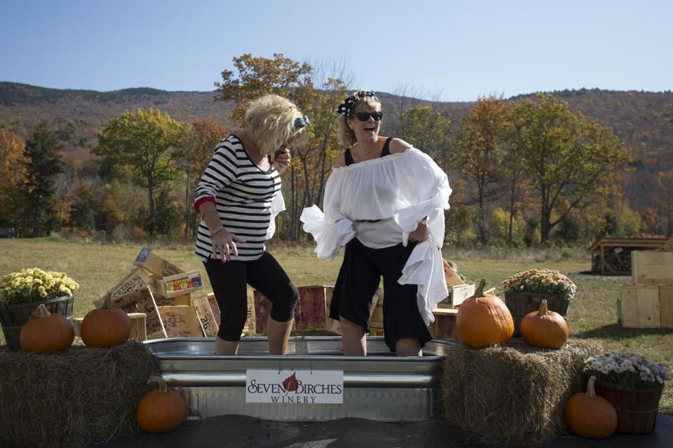 Visitors can roll up their pant legs, climb into a big steel tub barefoot, and crush grapes at the White Mountains Crush Festival at Loon Mountain.