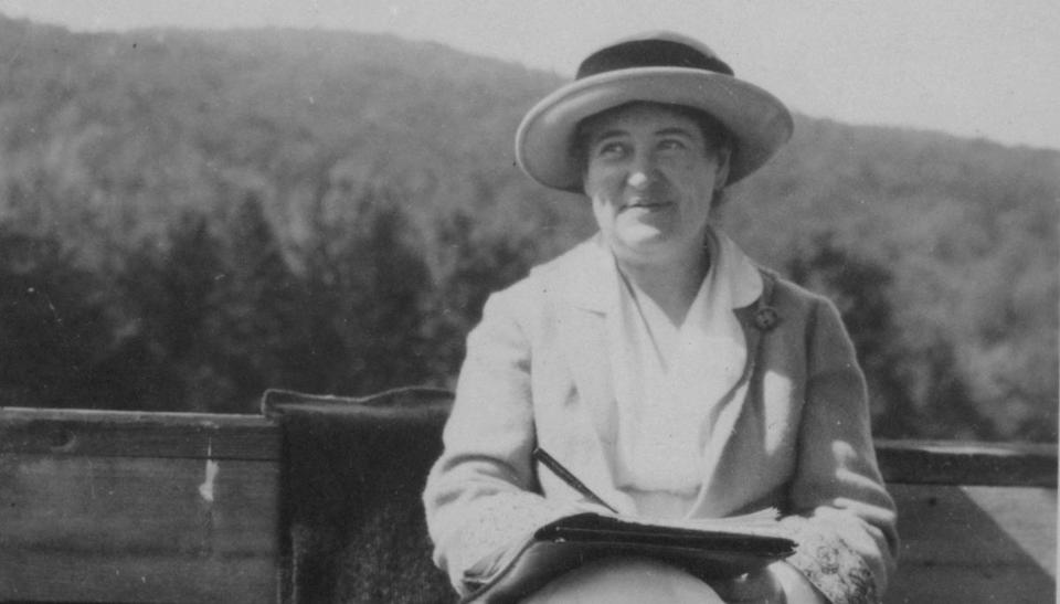 Willa Cather with Mount Monadnock in the background.