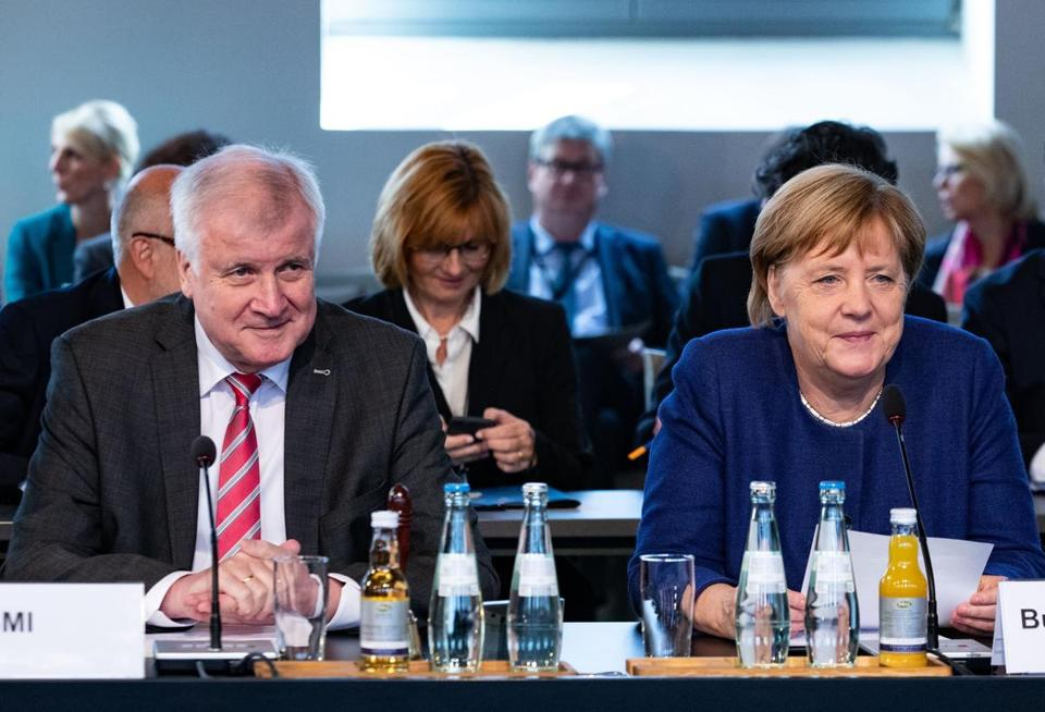 Mandatory Credit: Photo by HAYOUNG JEON/EPA-EFE/REX/Shutterstock (9896261e) (L-R) Minister of Interior, Construction and Homeland Horst Seehofer and German Chancellor Angela Merkel during the constituent meeting in Berlin, Germany, 26 September 2018.