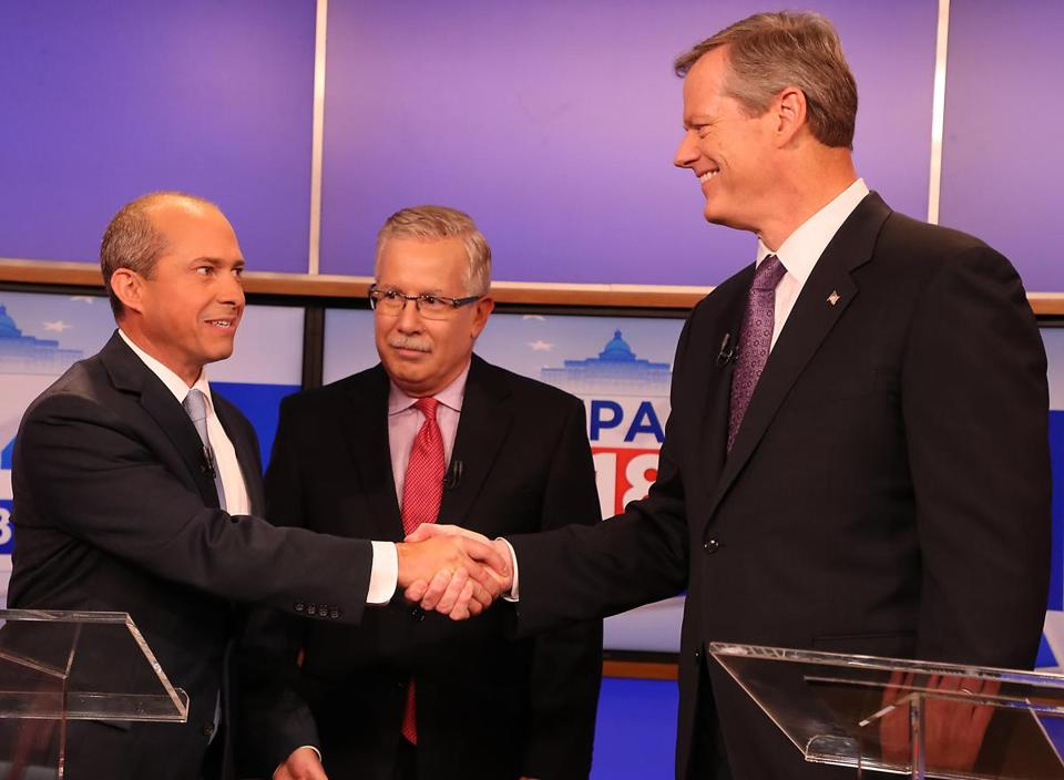 Governor Charlie Baker (right) shook hands with challenger Jay Gonzalez (left), as debate moderator Jon Keller looked on.