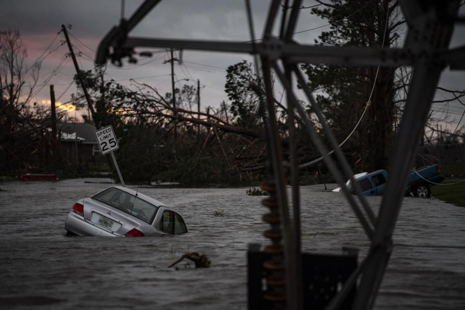 A car is seen caught in flood water in Panama City, Fla., after Hurricane Michael made landfall along the Florida panhandle on Oct. 10, 2018. MUST CREDIT: Washington Post photo by Jabin Botsford.