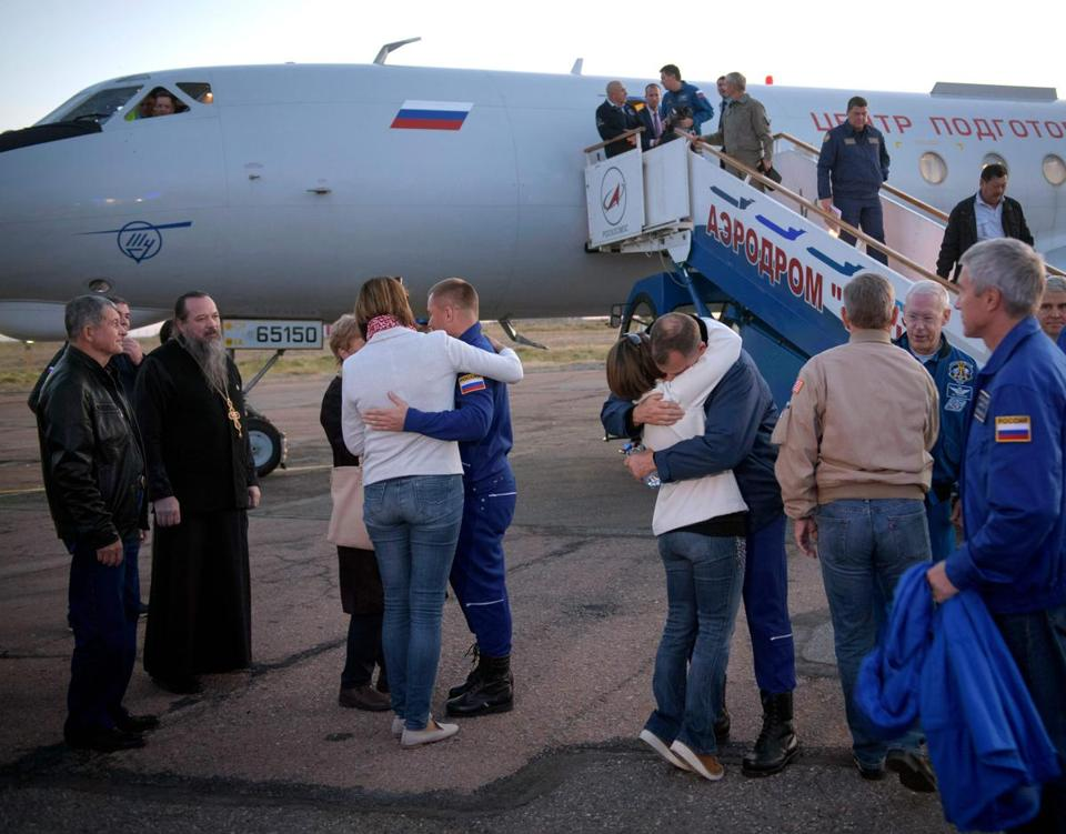"In this image released by NASA, Expedition 57 Flight Engineer Alexey Ovchinin (C L) of Roscosmos, and Flight Engineer Nick Hague (C R) of NASA, embrace their families after landing at the Krayniy Airport on October 11, 2018, in Baikonur, Kazakhstan. Hague and Ovchinin arrived from Zhezkazgan after Russian Search and Rescue teams brought them from the Soyuz landing site. - The two-man crew of a Soyuz rocket made a successful emergency landing Thursday after an engine problem on lift-off to the International Space Station, in a major setback for the beleaguered Russian space industry. Hague and Russian Ovchinin were rescued without injuries in Kazakhstan. (Photo by Bill INGALLS / (NASA/Bill Ingalls) / AFP) / RESTRICTED TO EDITORIAL USE - MANDATORY CREDIT ""AFP PHOTO / NASA / Bill INGALLS"" - NO MARKETING NO ADVERTISING CAMPAIGNS - DISTRIBUTED AS A SERVICE TO CLIENTSBILL INGALLS/AFP/Getty Images"