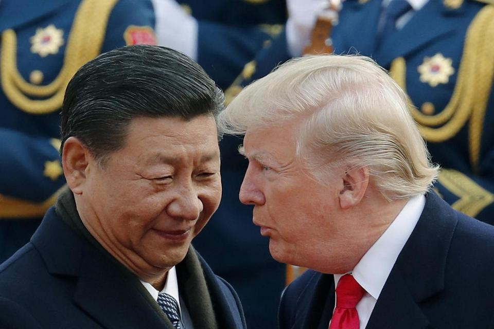 President Trump (right) and Chinese President Xi Jinping.