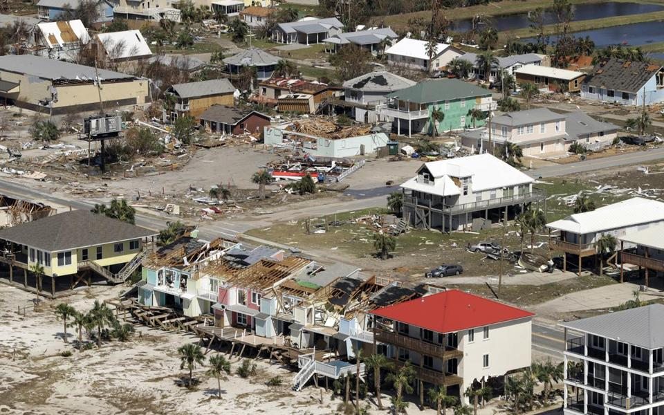 Homes destroyed by Hurricane Michael are shown in this aerial photo Thursday, Oct. 11, 2018, in Mexico Beach, Fla. The devastation inflicted by Hurricane Michael came into focus Thursday with rows upon rows of homes found smashed to pieces, and rescue crews began making their way into the stricken areas in hopes of accounting for hundreds of people who may have stayed behind. (AP Photo/Chris O'Meara)