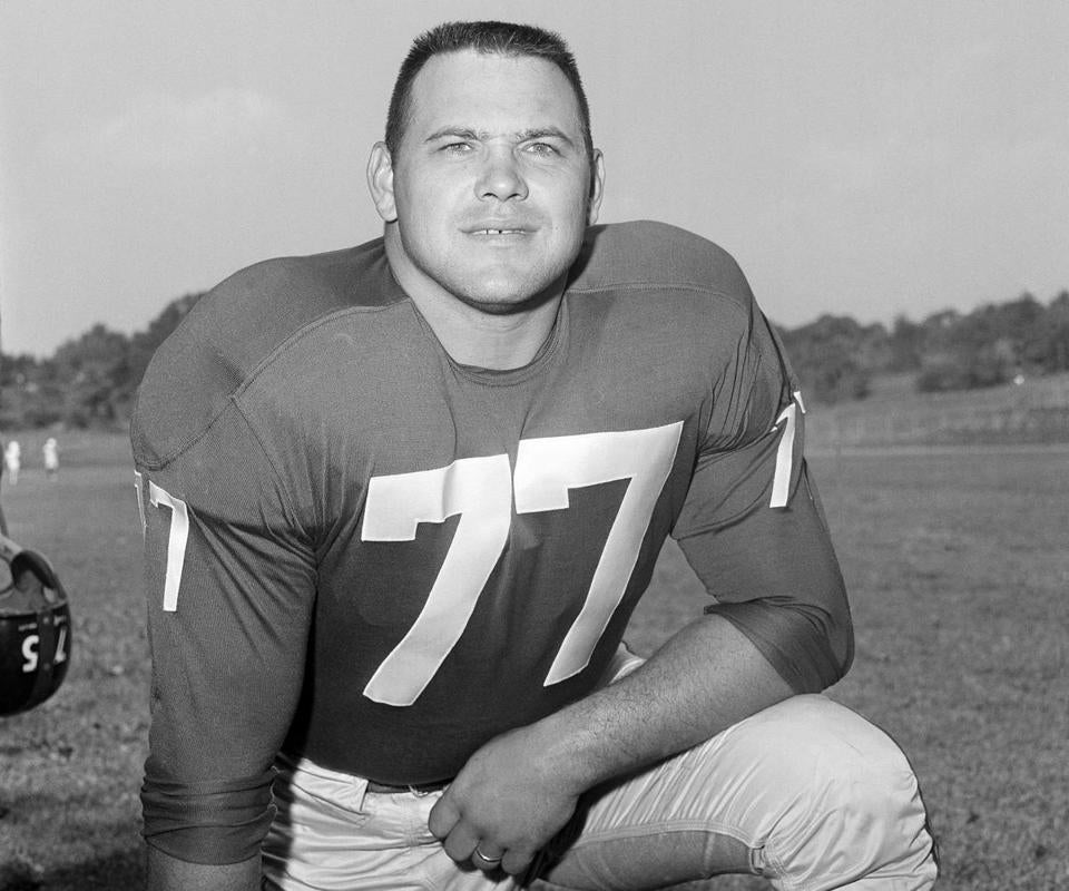 Mr. Modzelewski won the 1956 NFL title with the Giants. When he retired after 14 seasons in the NFL, he had played in a league-record 180 consecutive games.