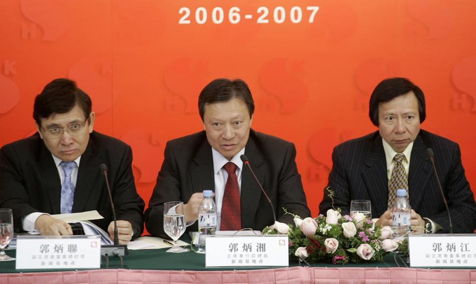 FILE - In this March 7, 2007 file photo, Walter Kwok, center, chairman and chief executive, Raymond Kwok, left, and Thomas Kwok, right, both vice chairman and managing director, of Sun Hung Kai Properties attend a press conference to announce their company's interim results in Hong Kong. Walter Kwok was arrested Thursday, May 3, 2012 in a high profile anti-corruption probe that has already targeted his billionaire brothers and a top official. (AP Photo/Vincent Yu, File)
