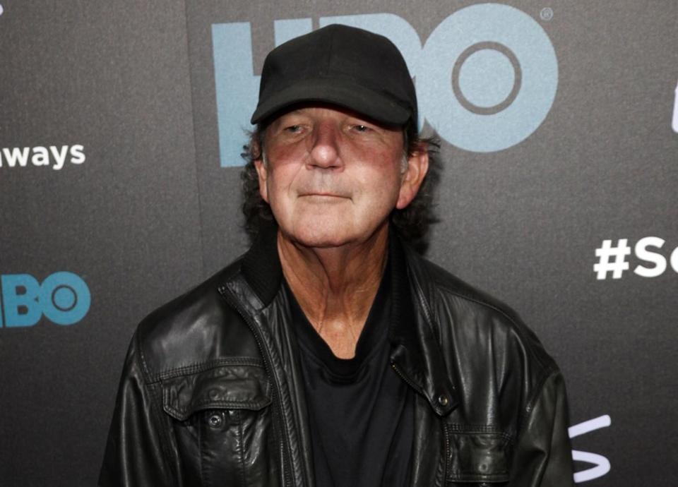 "FILE - In this Oct. 14, 2014 file photo, Tony Joe White attends the premiere of HBO's ""Foo Fighters Sonic Highway"" in New York. White, who had a hit in 1969 with ""Polk Salad Annie"" and whose songs were covered by music greats like Elvis Presley, Hank Williams Jr., Tina Turner, Ray Charles and Waylon Jennings, died Wednesday, Oct. 24, 2018. He was 75. (Photo by Andy Kropa/Invision/AP, File)"