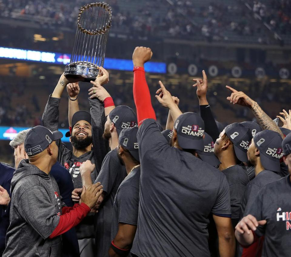 David Price was surrounded by his teammates as he hoisted the trophy after winning the World Series.