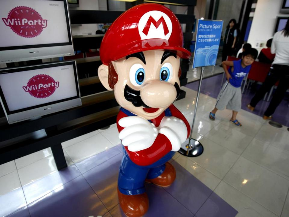 A boy looked at a model of Nintendo's Super Mario at the Japanese game maker's showroom in Tokyo in 2010.