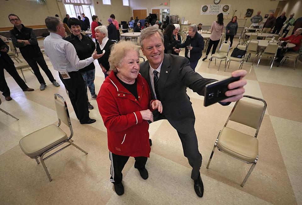 Governor Charlie Baker greeted senior Mary Tymowicz at the Lowell Senior Center.