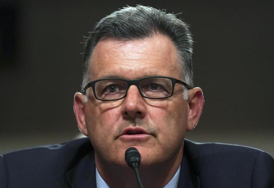 FILE - In this June 5, 2018 file photo, former USA Gymnastics president Steve Penny invokes his right under the Fifth Amendment during a hearing on Capitol Hill in Washington. Penny has pleaded not guilty to a charge in Texas of tampering with evidence in the sexual assault investigation of now-imprisoned gymnastics doctor Larry Nassar. Penny entered his plea during a court appearance in Huntsville, Texas, on Monday Oct. 29, 2018. (AP Photo/Carolyn Kaster, File)