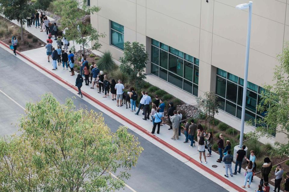 People wait in line to cast their ballot at a polling station in San Diego Tuesday.