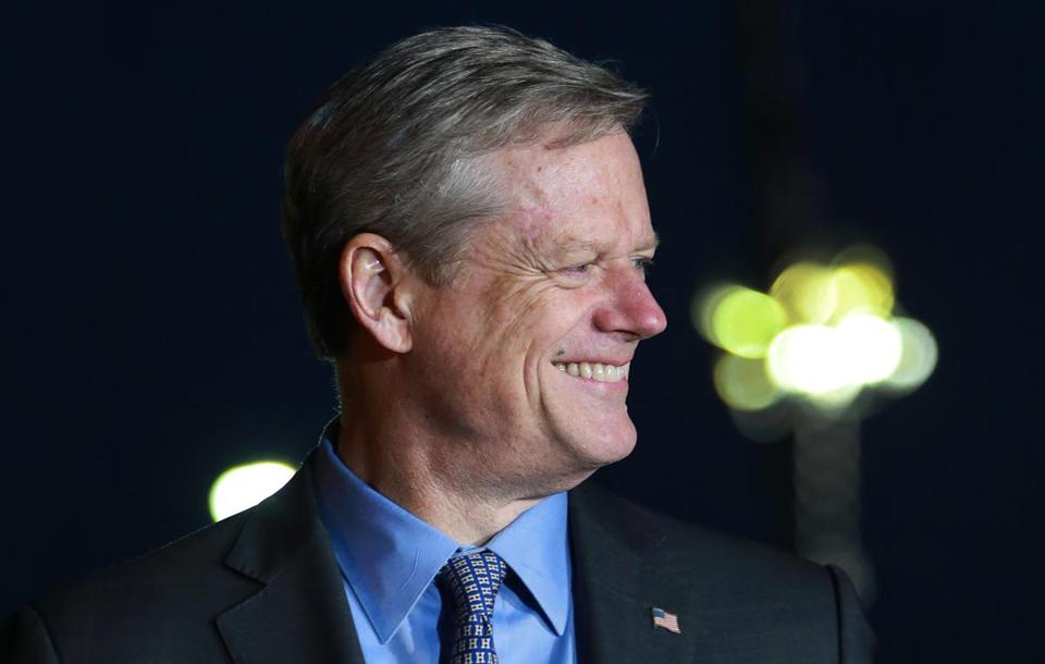 Governor Charlie Baker during a light moment Wednesday evening after Mayor Daniel Rivera of Lawrence (not pictured) made a joke at his own expense as they spoke to reporters outside the headquarters of Columbia Gas in Lawrence.